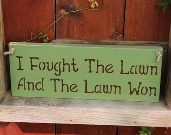 I fought the lawn and the lawn won wooden garden sign
