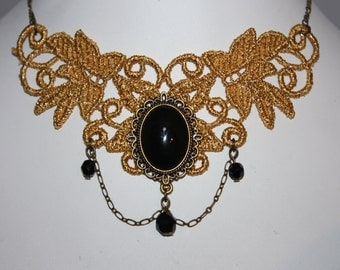 beautiful gold lace necklace with black glass cabochon