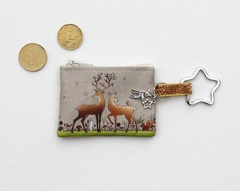 """Keyring / mini wallet in lin illustrates """"the deer and the deer"""""""