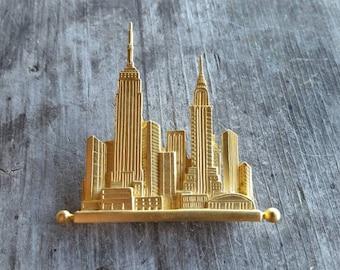 JJ 1988 Gold Tone City Skyline Brooch