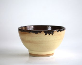 yellow ceramic bowl and inner variations of brown, handmade