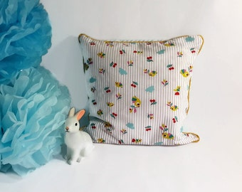 """Removable square cushion for baby's room, in striped cotton light bleu & white and printed fabric, """"Summery""""theme, hand-made in France."""