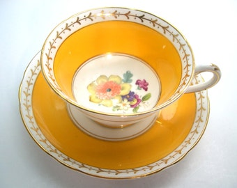 1920's Antique  Grosvenor Jackson & Gosling Tea cup and saucer set, Ye Old English, Bright Yellow with flowers