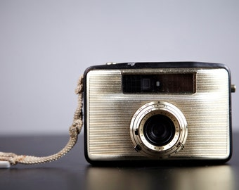 Film Camera.Penti II. Vintage half-frame camera. Working shutter.