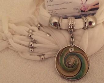 Swirled Glass charm on white colored scarf