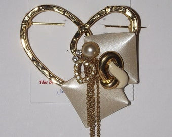 Elegant Theme. 1-of-a-Kind collage brooch, made from recycled vintage jewelry. Gold, pearl, cream, beige, rhinestones. #94.