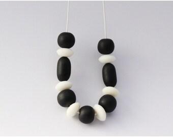Black & White Resin Bead Necklace on White Waxed Cotton