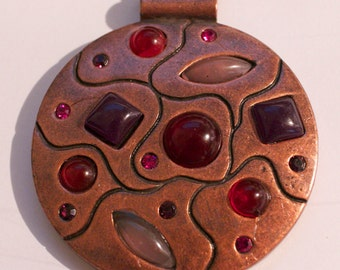 Large Round bronze colour  pendant with dark red and pink stones