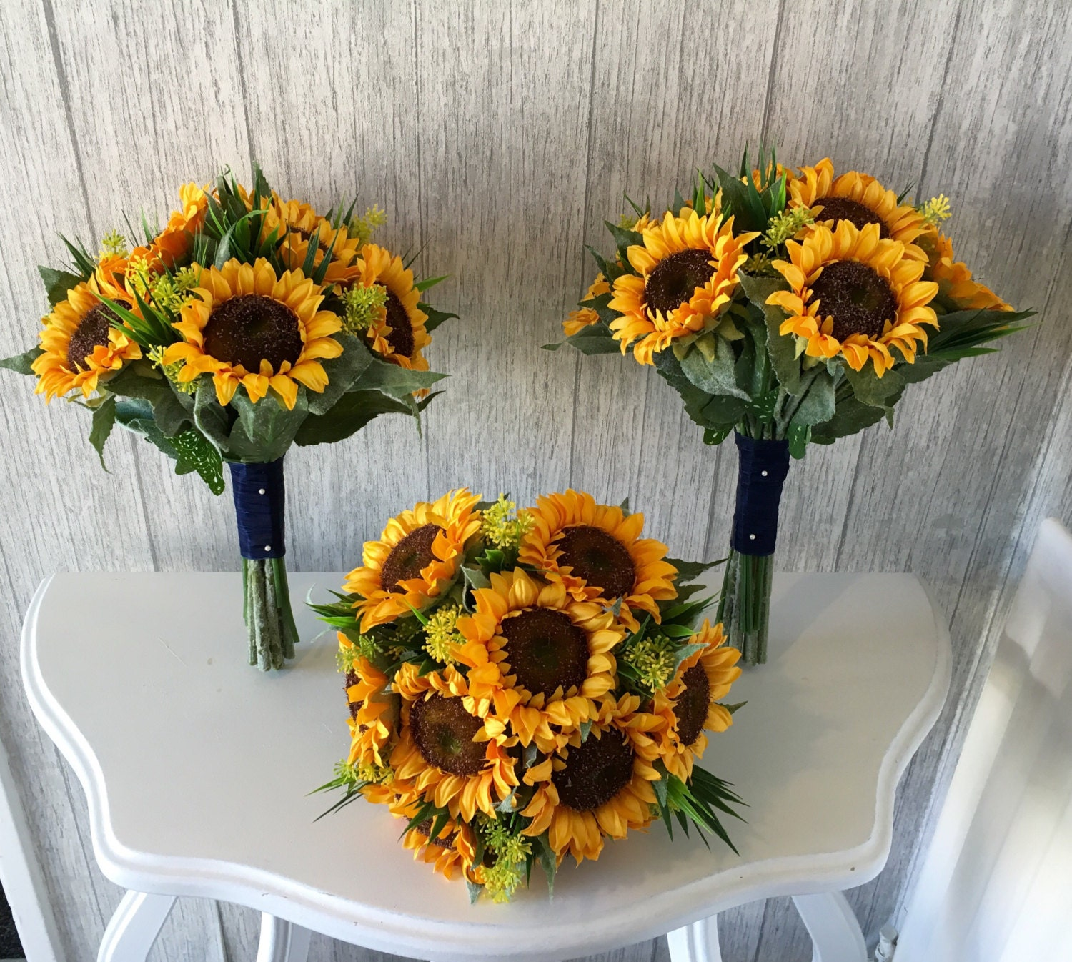Artificial sunflower bouquet finished with lace price is for