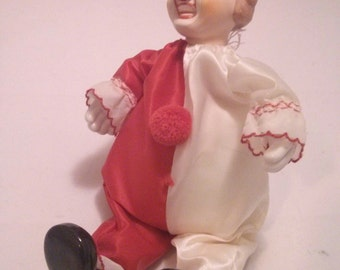 Vintage Creepy Porcelain and fabric Clown Musical Doll