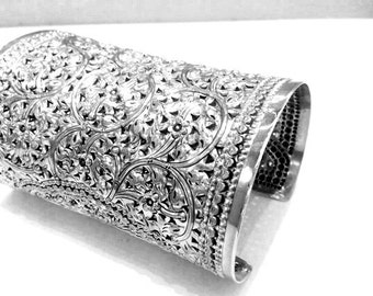 Silver cuff bracelet with engravings