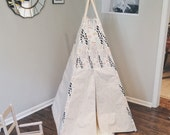 canvas slim teepee hand stamped with floral accent and poplar dowel poles.