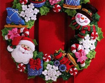 Bucilla Christmas Toys Wreath ~ Felt Home Decor Kit #86363, Santa, Frosty, Train DIY