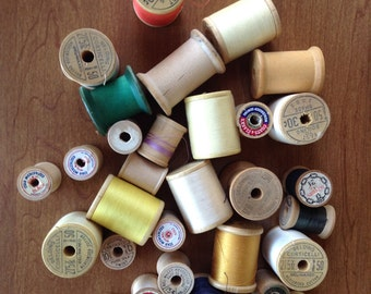 Wooden sewing thread spools