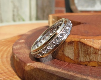 A 9k yellow and white gold eternity ring