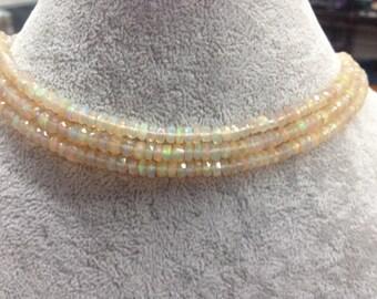 Ethiopian Opal faceted rondells  4-5mm