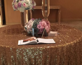 Solid Gold sequin table cloth completely covered in sparkling sequins