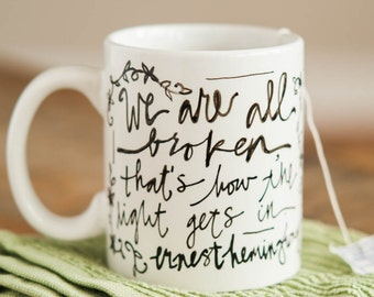 Mug Quote: We are all broken, that's how the light gets in. Ernest Hemingway. Handpainted mug. Porcelain mug for literature lovers. Gift.