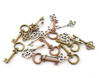 17 Antique Silver, Copper and Antique Brass Key Charms
