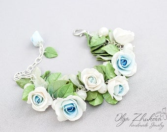 Bracelet  with white and blue roses made of polymer clay