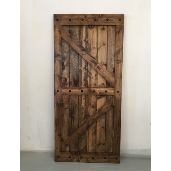 Nail Head Trimmed Sliding Barn Door British Brace Design