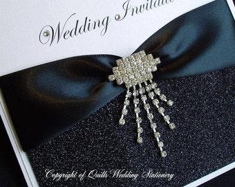 Gatsby. Art Deco Wedding Invitation with Black Glitter and Diamanté Drop Embellishment.