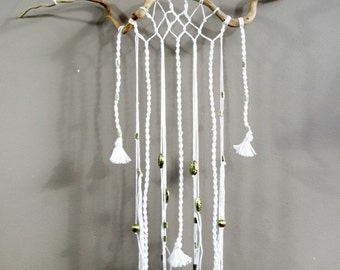 Wall hanging decor with driftood and white wool