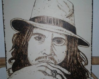 Wood-ash picture starring Johnny Depp