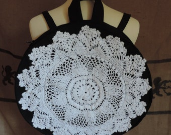 Black round backpack, white lace