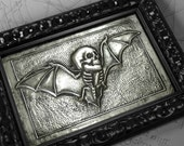 Skullbat : hand embossed anatomical repoussé metal wall art