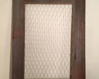 Chicken wire framed with barn wood