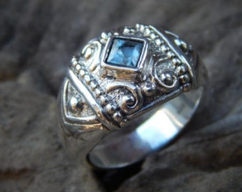Silver ring patra motif with blue topaz stone