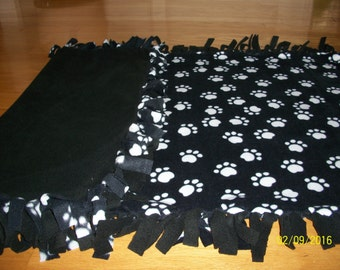 Fleece Blanket for your poochie decorated with Black and White Paws