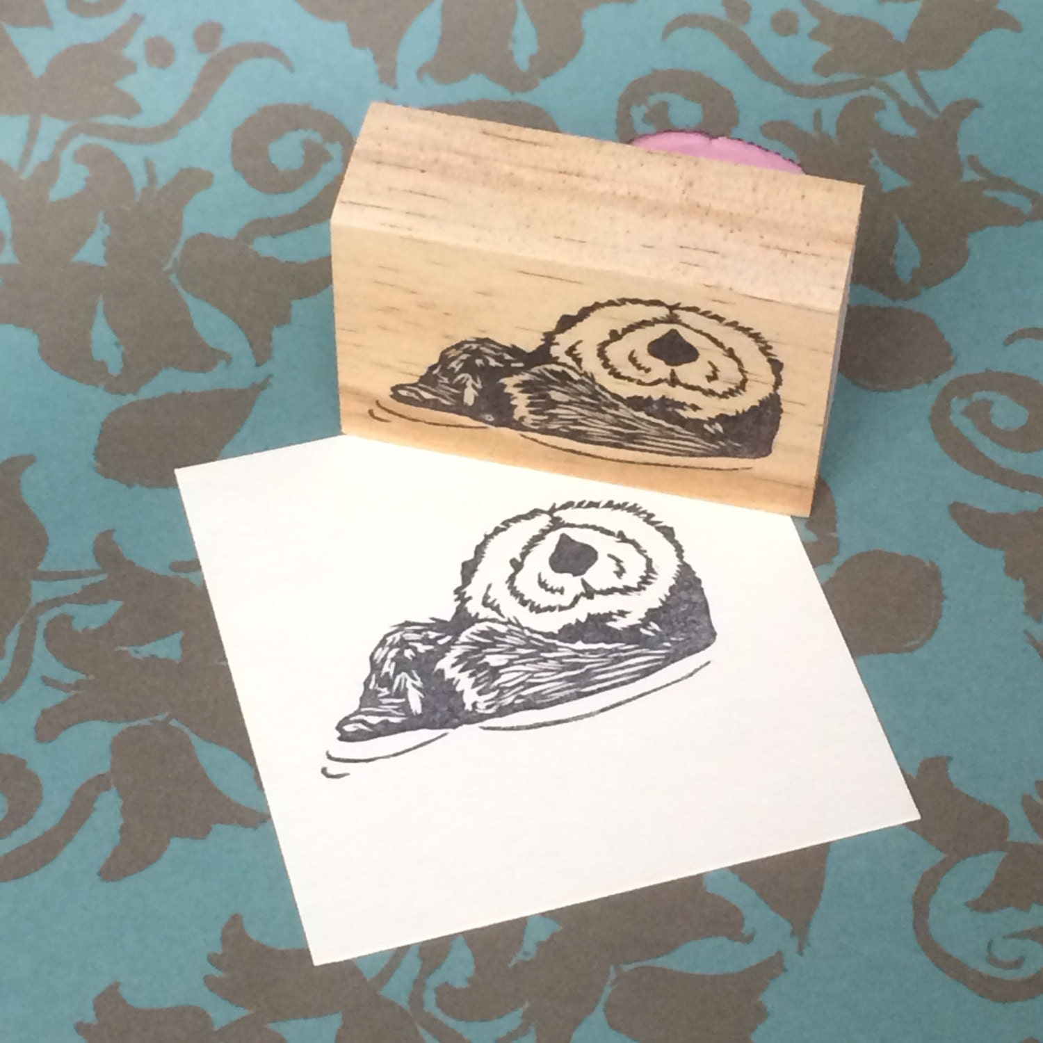 Hand carved rubber stamp otter design from
