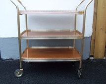 1960's Bar cart, rolling drinks trolley, three tiers. Mid century tea trolley hostess.Home bar, bronze and wood effect, three shelves.