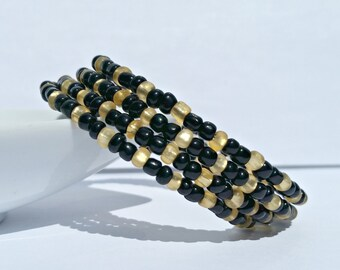 Memory wire bracelet. Black and gold seed beads