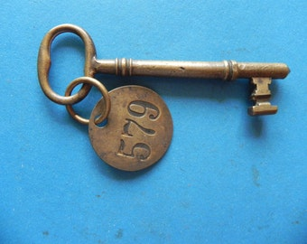"Antique Brass Skeleton key W/ Brass tag. 4"" Long. Old & Original."