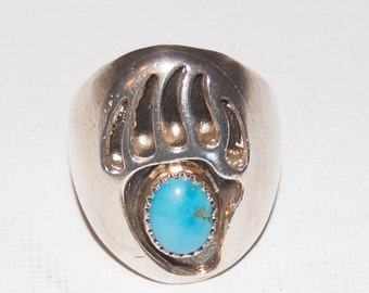 Navajo sterling silver ring with small turquoise stone, bear claw design