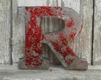 A fantastic vintage style metal 3D red letter R