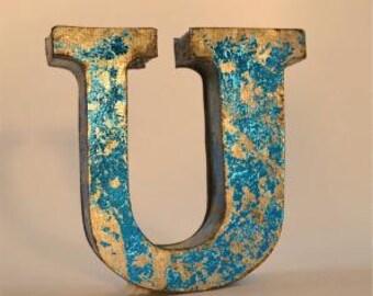 A fantastic vintage style metal 3D blue letter U