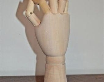 Fantastic carved wooden articulated right hand