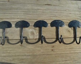 A set of 5 hand wrought iron primitive folk art hooks QHH1