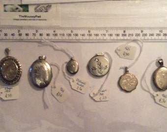 Selection of six beautiful vintage silver lockets, furthest left sold!
