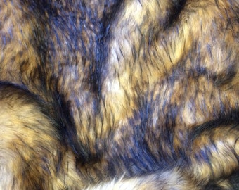 Astonishing faux fur wolf brown fabric. Sold by the yard.
