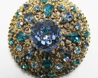 "Vintage 1950s Signed ""Made in Austria"" Gold Toned Blue and Teal Rhinestone Pin"