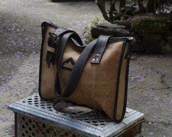 handmade handbag in brown and black leather