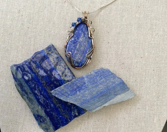 Beautiful Wire wrapped Lapis oval shaped pendant. Hand cut and polished. Wire wrapped in Sterling silver and rose gold fill.