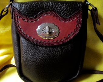 Soft Black Chap Leather Hand Bag with Tooled leather Flap and Twist Lock.