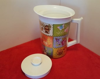 Vintage thermo serv insulated pitcher, 1 1/2 quart pitcher, embroidered,  quilted themed, mushroom, butterflies, bees and flowered pitcher