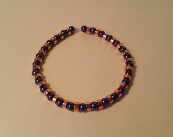 Navy blue and rose gold beaded bangle.